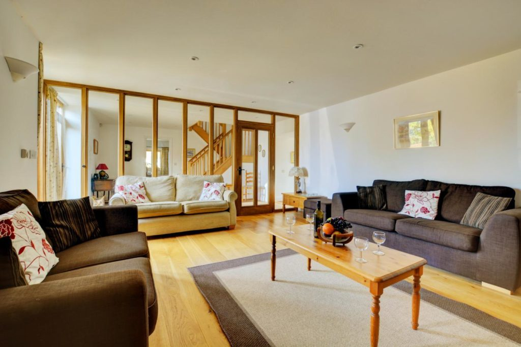 Family friendly accommodation - living room with sofas and a coffee table