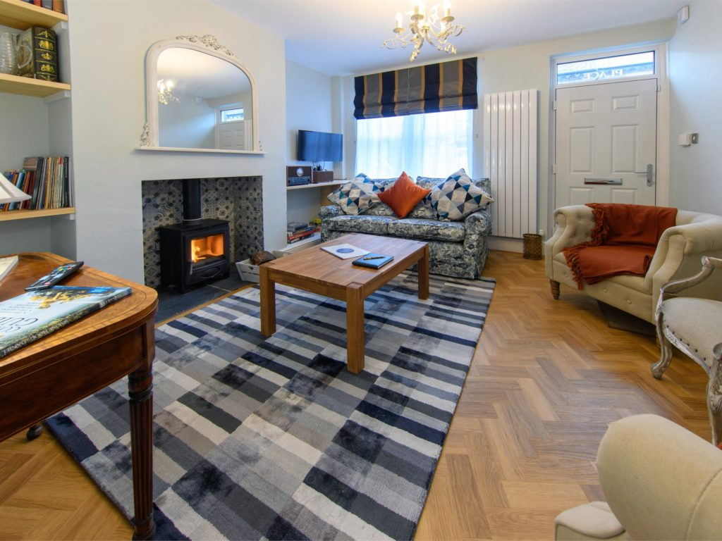 family-friendly cottage - well decorated living room with a roaring fire