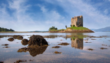 A view of a castle on a hill, one of the unmissable places to visit in Argyll and Bute