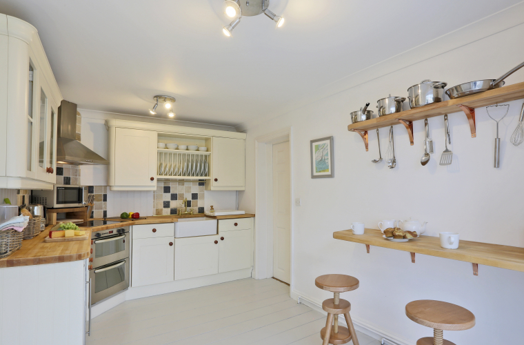 A bright, white and well-equipped kitchen