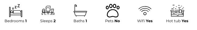 Property details: one bedroom, sleeps two, one bathroom, no pets, has wifi, has a hot tub