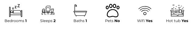 Property details: one bedroom, sleeps two, one bath, no pets, has wifi, has a hot tub