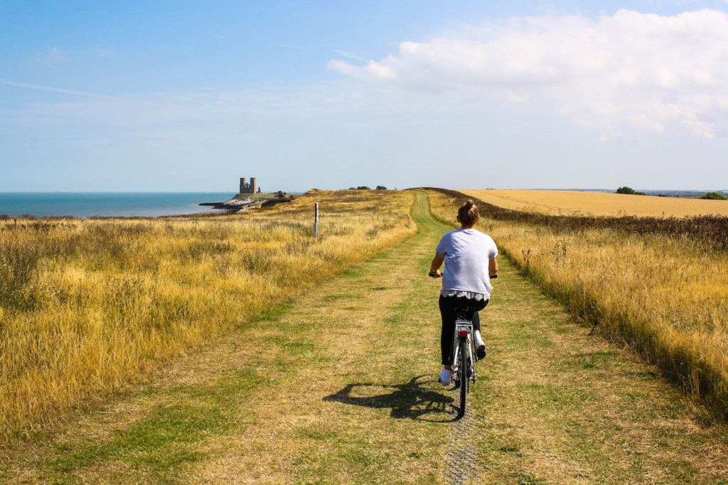 A person cycling along the coast near Whitstable, Kent