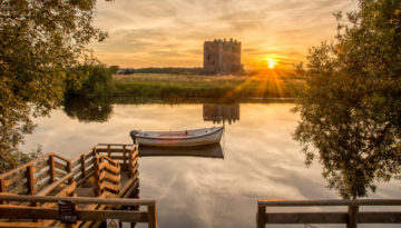 A shot of the sunset over the River Dee, showcasing the beauty of one of the best towns to stay in Scotland