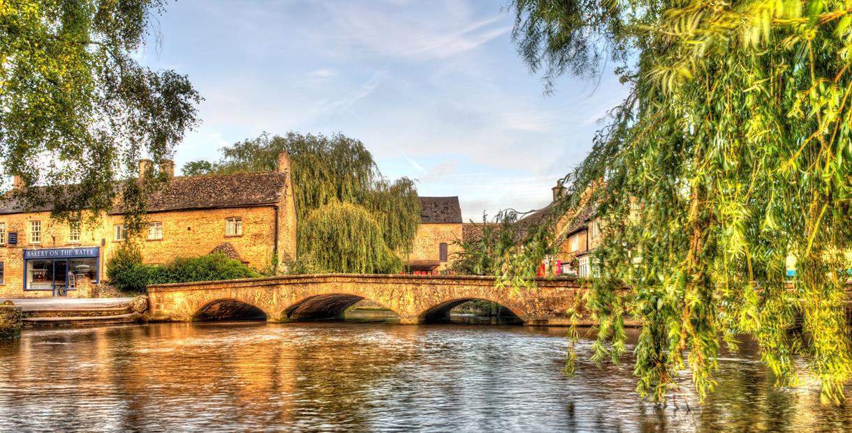 Sail along the picturesque Bourton-on-the-water, one of the 10 best things to do in the Cotswolds