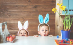 Two kids enjoying their best Easter family holiday